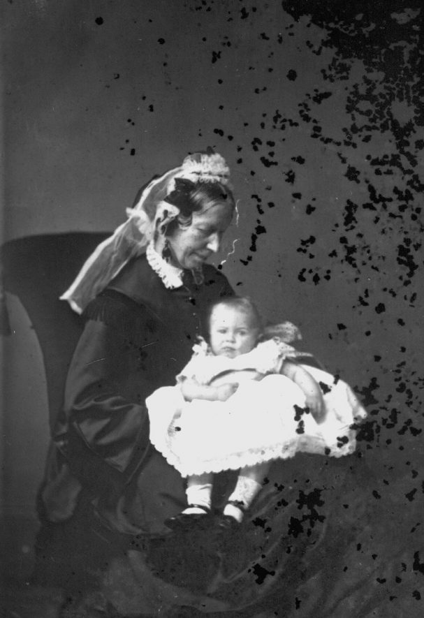 Portrait of woman and baby  with the surname Walls.  1874 |  IMAGE LOCATION: (Warwickshire County Record Office) PEOPLE IN PHOTO: Walls as a surname
