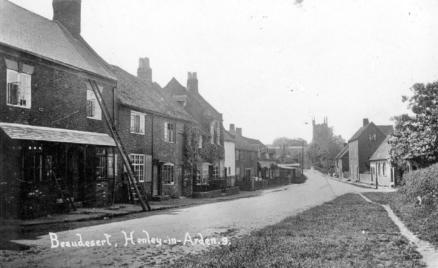 Beaudesert street with church tower in distance.  1910s |  IMAGE LOCATION: (Warwickshire County Record Office)
