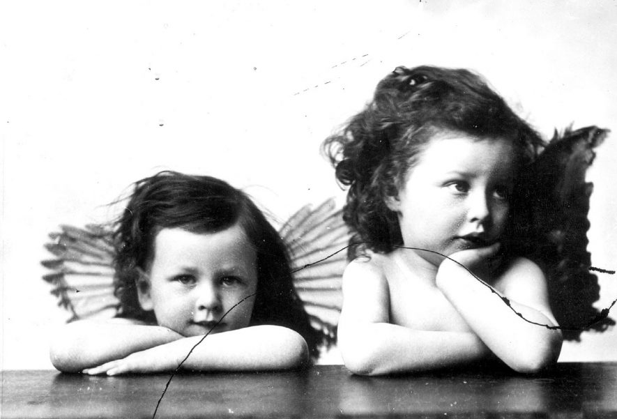 Two little girls with the surname Graub dressed as angels [homage to Raphael?].  1875 |  IMAGE LOCATION: (Warwickshire County Record Office) PEOPLE IN PHOTO: Graub as a surname
