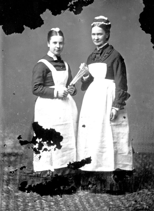 Portrait of two domestic servants.  1879 |  IMAGE LOCATION: (Warwickshire County Record Office)
