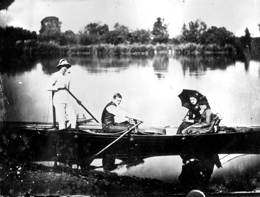 Two men and two women (Edlmann family) in a rowing boat on a lake.  1880s |  IMAGE LOCATION: (Warwickshire County Record Office) PEOPLE IN PHOTO: Edlmann as a surname