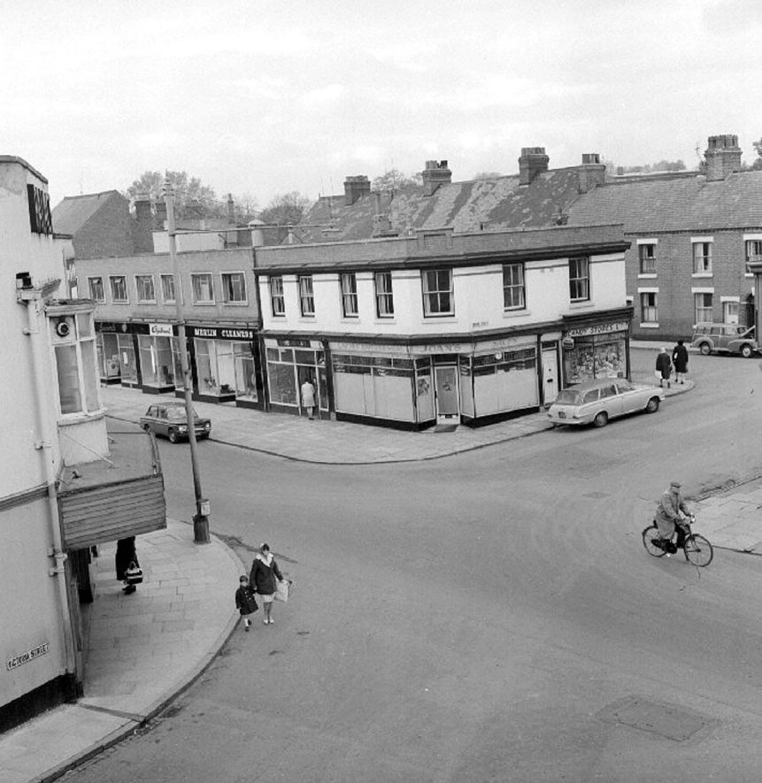 Properties on the corner of Broad Street and Queen's Road, Nuneaton. The Palace cinema can just be seen to the extreme left of the picture.  October 3rd 1966 |  IMAGE LOCATION: (Warwickshire County Record Office)