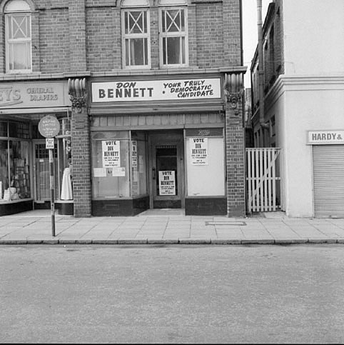 Entrance and shop front of the old Boot's shop in Coventry Street, Nuneaton. When this picture was taken it was in use as election headquarters for Don Bennett in the election for Nuneaton's M.P.  March 5th 1967    IMAGE LOCATION: (Warwickshire County Record Office)
