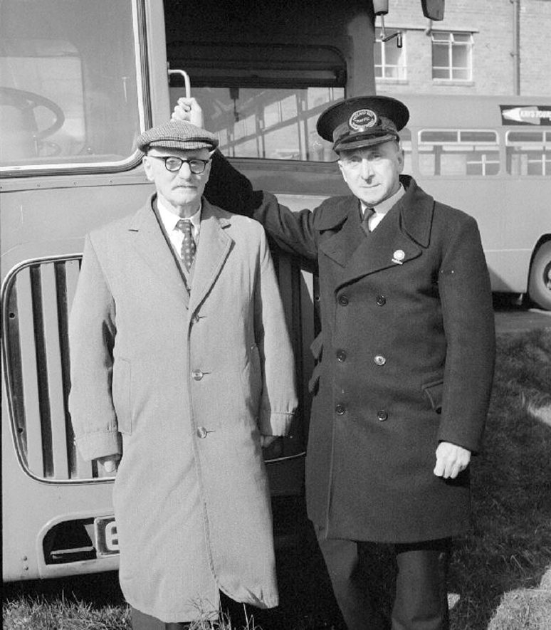 Mr F.J. Scarr and Mr Hackett at the Midland Red bus garage in Newtown Road, Nuneaton. Mr Scarr drove the first petrol electric bus in Nuneaton fifty years ago.  March 19th 1967 |  IMAGE LOCATION: (Warwickshire County Record Office) PEOPLE IN PHOTO: Scarr, F J, Hackett, A C