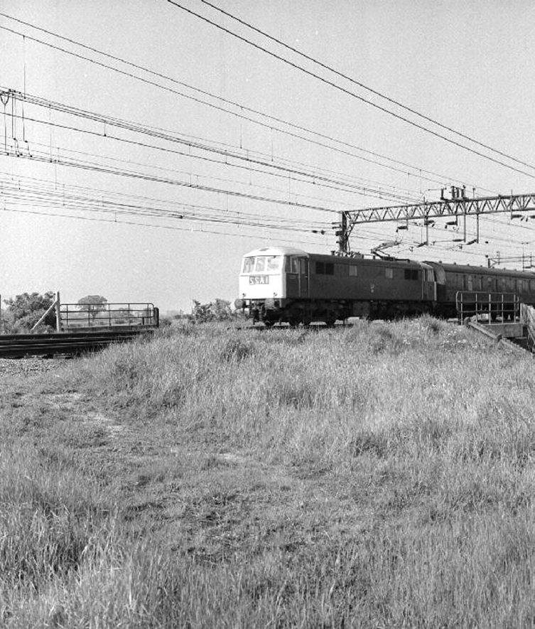 An express train to London crossing the bridge in Weddington Meadows before entering Nuneaton's Trent Valley Station.  May 31st 1967 |  IMAGE LOCATION: (Warwickshire County Record Office)