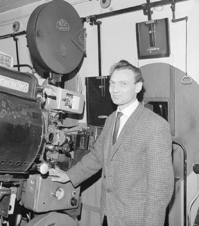 Mr Alan Watts, second projectionist, standing beside the projector at The A.B.C