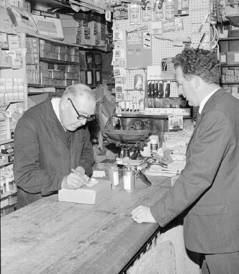 Mr R A Collett serving a customer in his ironmonger's shop in Queens Road, Nuneaton.  August 30th 1968 |  IMAGE LOCATION: (Warwickshire County Record Office) PEOPLE IN PHOTO: Collett, Ronnie A, Collett as a surname