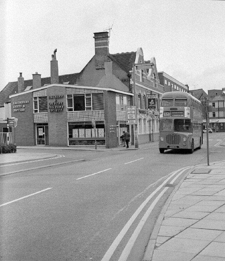 Bus travelling up Church Street, Nuneaton. Shortly after this picture was taken a one way system was introduced and traffic could only travel towards Bond Street.  1st September 1968 |  IMAGE LOCATION: (Warwickshire County Record Office)