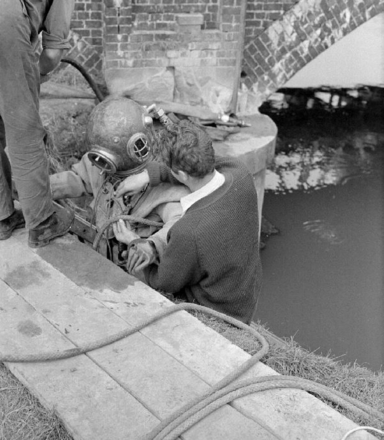Diving operations in the River Tame, Coleshill, whilst carrying out repairs to the road bridge on the A446 road. Picture shows Mr Alan Carr in diving outfit on the ladder.  September 8th 1968. |  IMAGE LOCATION: (Warwickshire County Record Office) PEOPLE IN PHOTO: Carr, Alan, Carr as a surname