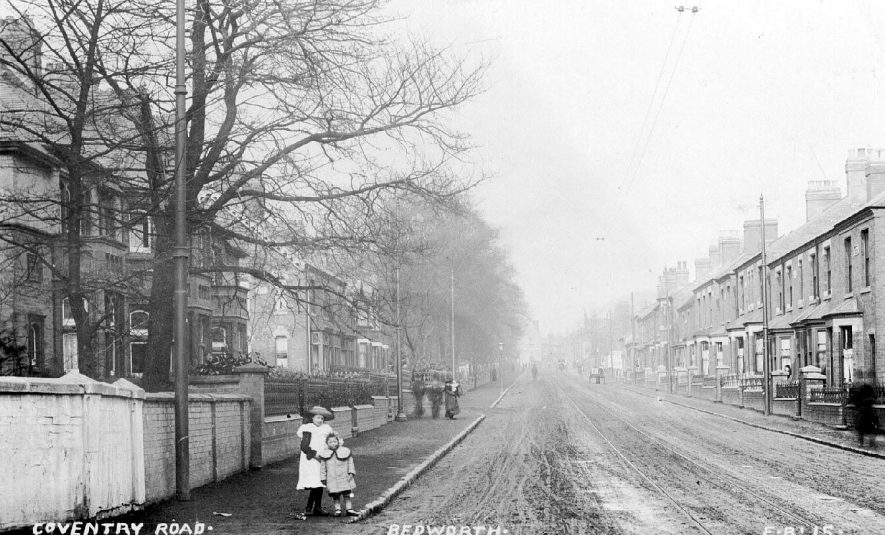Coventry Road, Bedworth. Street scene with children and adults walking along pavement.  1900s |  IMAGE LOCATION: (Warwickshire County Record Office)