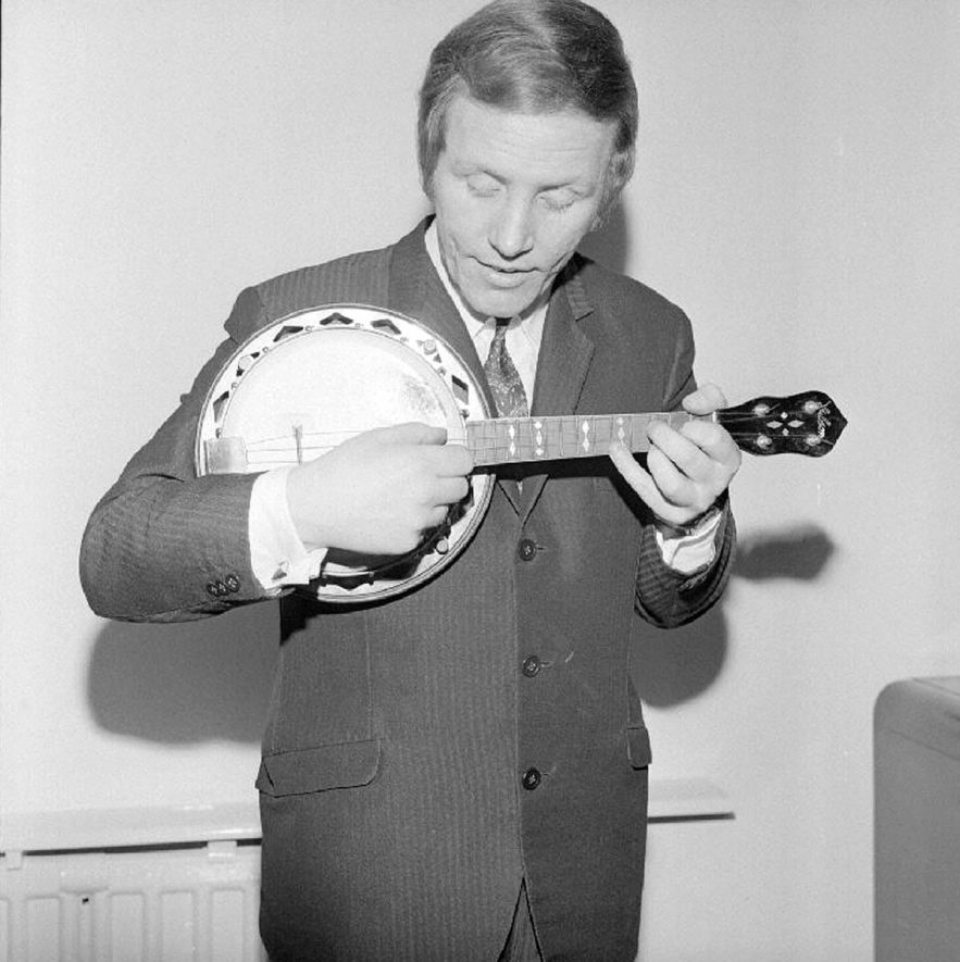 Alan Randall, the new George Formby, pictured playing George Formby's ukulele at his home in Hinkley Road, Nuneaton.  February 22nd 1969 |  IMAGE LOCATION: (Warwickshire County Record Office) PEOPLE IN PHOTO: Randall, Alan, Randall as a surname