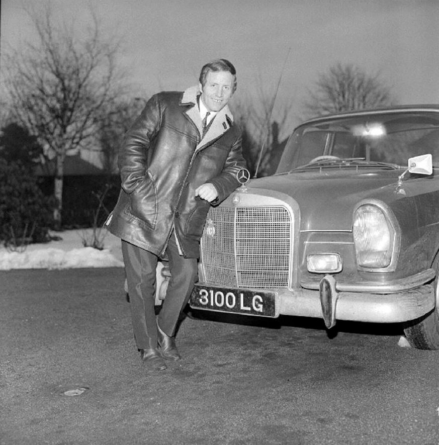 Alan Randall, the new George Formby, standing beside his Mercedes car at his home in Hinckley Road, Nuneaton.  February 22nd 1969 |  IMAGE LOCATION: (Warwickshire County Record Office) PEOPLE IN PHOTO: Randall, Alan, Randall as a surname