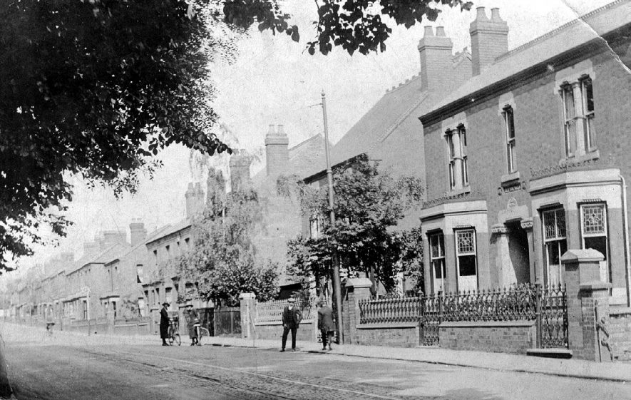 Coventry Road, Bedworth. People walking along street and stopping to talk to one another.  1900s |  IMAGE LOCATION: (Warwickshire County Record Office)