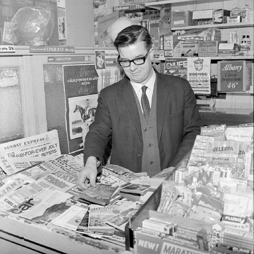 Stanley Firmstone at the counter of his Newsagents shop in Abbey Street, Nuneaton.  2 March 1969 |  IMAGE LOCATION: (Warwickshire County Record Office) PEOPLE IN PHOTO: Firmstone, Stanley, Firmstone as a surname