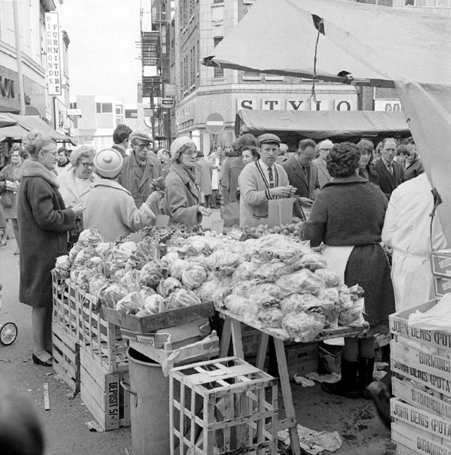 Fruit and vegetable stall in Nuneaton Market Place.  19 April 1969 |  IMAGE LOCATION: (Warwickshire County Record Office)