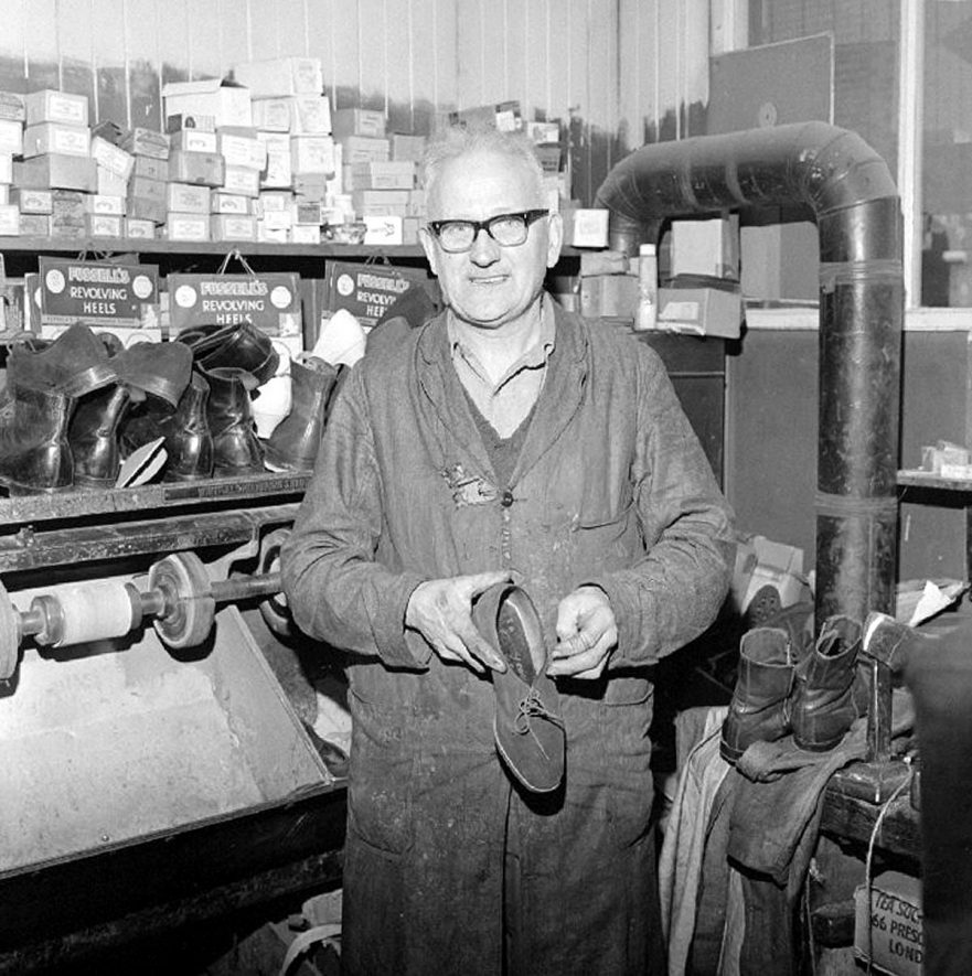 Mr Alfred King, aged 61, boot and shoe repairer, pictured at his shop  26 Windsor street, Nuneaton.  22 April 1969 |  IMAGE LOCATION: (Warwickshire County Record Office) PEOPLE IN PHOTO: King, Alfred, King as a surname