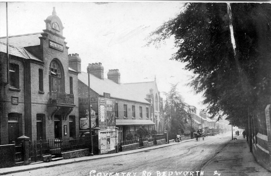 Coventry Road, Bedworth, people walking along road past the Conservative Club. Chapel and Victoria Hall.  1900s |  IMAGE LOCATION: (Warwickshire County Record Office)