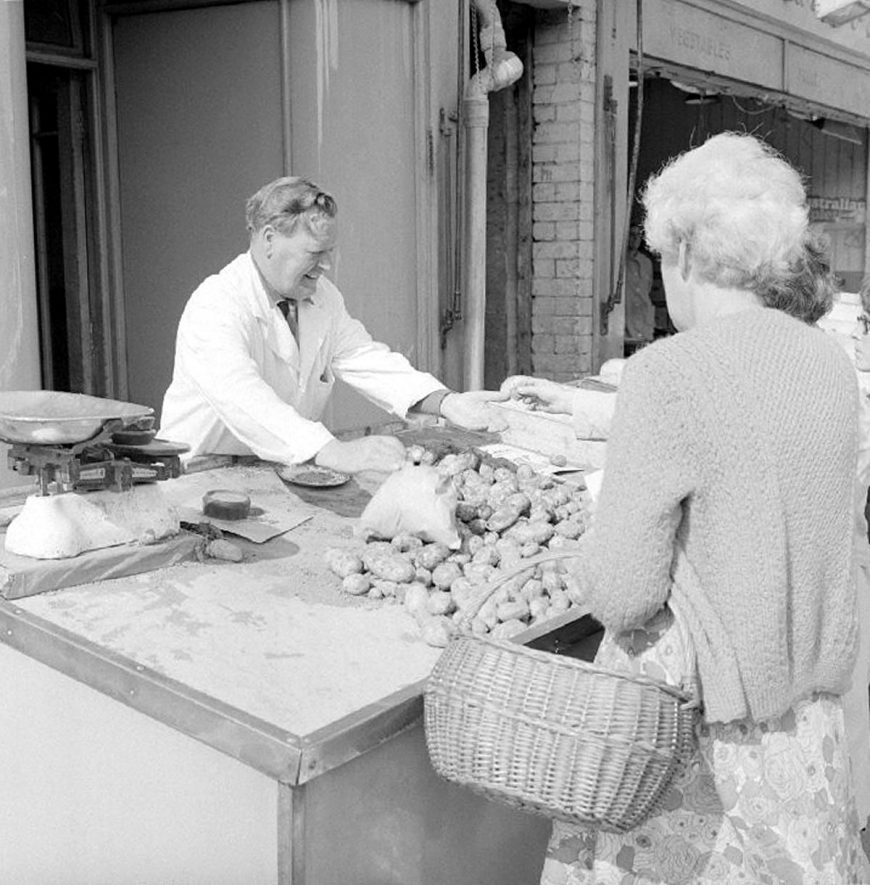 Frank Smith working in Clarke's fruit and vegetable shop in Queens Road, Nuneaton.  1969 |  IMAGE LOCATION: (Warwickshire County Record Office) PEOPLE IN PHOTO: Smith, Frank, Smith as a surname