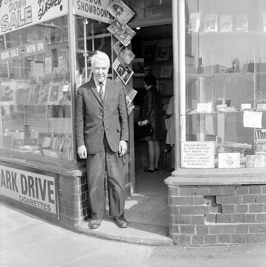 Reg Hadden outside his newsagents shop in Queens Road, Nuneaton.  1969 |  IMAGE LOCATION: (Warwickshire County Record Office) PEOPLE IN PHOTO: Hadden, Reg, Hadden as a surname