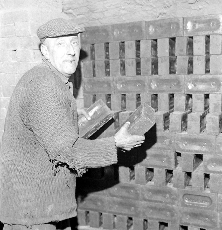 Frank Alton stacks a kiln at the Coal Board's Ansley Hall Brick Works, Ansley.  1969 |  IMAGE LOCATION: (Warwickshire County Record Office) PEOPLE IN PHOTO: Alton, Frank, Alton as a surname
