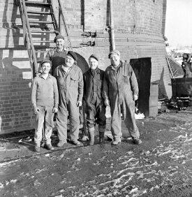 Ansley Hall brick works.  From left, Mark Lakin, Herbert Beale (at rear), Tom Matthews, Dennis Blower and Wilf Matthews.  1969    IMAGE LOCATION: (Warwickshire County Record Office) PEOPLE IN PHOTO: Matthews, Wilf, Matthews, Tom, Matthews as a surname, Lakin, Mark, Lakin as a surname, Blower, Dennis, Blower as a surname, Beale, Herbert, Beale as a surname
