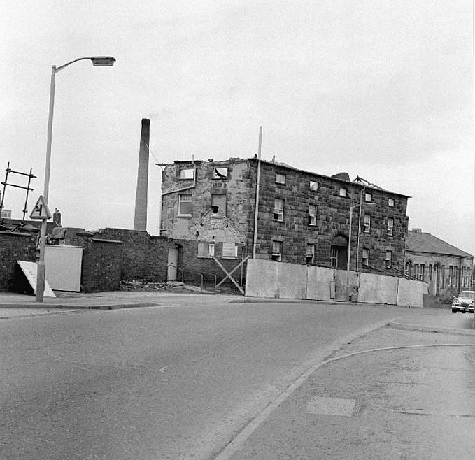Demolition of the old workhouse (College for the Poor), College Street, looking towards The Bullring, Nuneaton.  March 13th 1971 |  IMAGE LOCATION: (Warwickshire County Record Office)