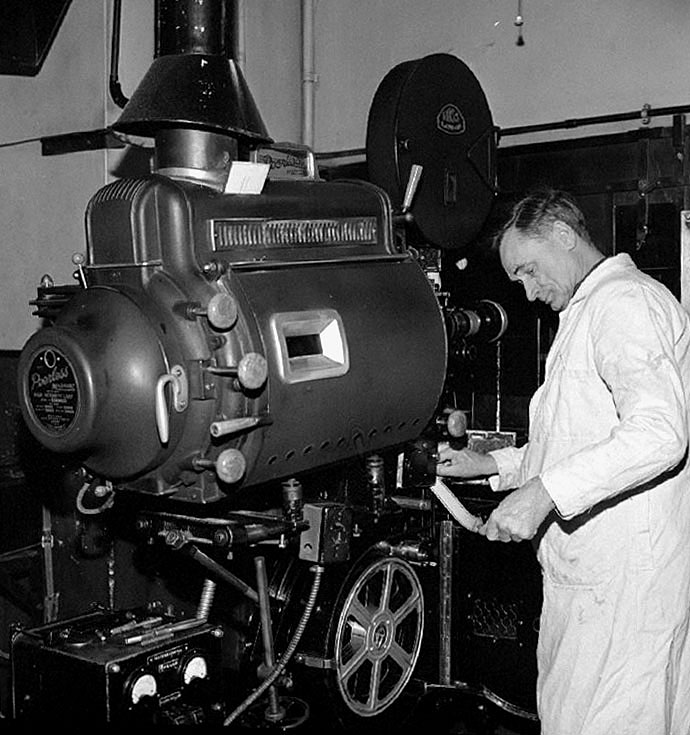 Mr Bert Healey at number one projector in the projection box at the Palace Cinema, Queens Road, Nuneaton.  January 28th 1972 |  IMAGE LOCATION: (Warwickshire County Record Office) PEOPLE IN PHOTO: Healey, Bert, Healey as a surname