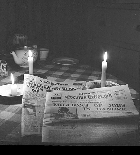 Pictures by candlelight, during a power cut caused by the miner's strike. Picture shows the headlines of The Tribune and The Coventry Telegraph.  February 18th 1972 |  IMAGE LOCATION: (Warwickshire County Record Office)