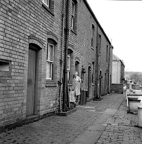 Mrs Elsie Smith in the doorway of her house at 66 Arthur Street, Chilvers Coton, Nuneaton, prior to its demolition.  March 25th 1972 |  IMAGE LOCATION: (Warwickshire County Record Office) PEOPLE IN PHOTO: Smith, Elsie, Smith as a surname