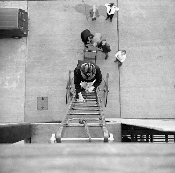 View from the top of the tower showing firemen climbing ladder at the firestation, Newtown Road, Nuneaton.  August 22nd 1972 |  IMAGE LOCATION: (Warwickshire County Record Office)
