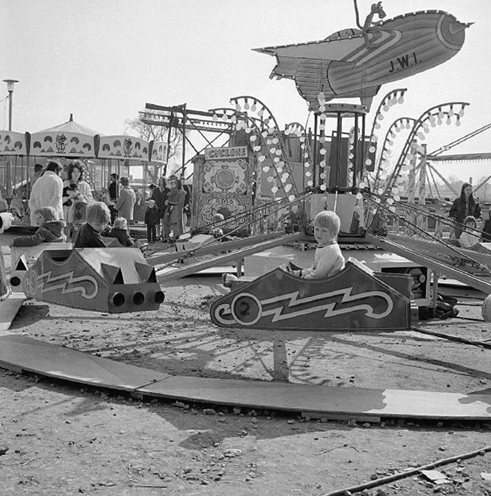 Children enjoying a ride at Barker's spring fair in The Pingles, Nuneaton.  April 15th 1973 |  IMAGE LOCATION: (Warwickshire County Record Office)