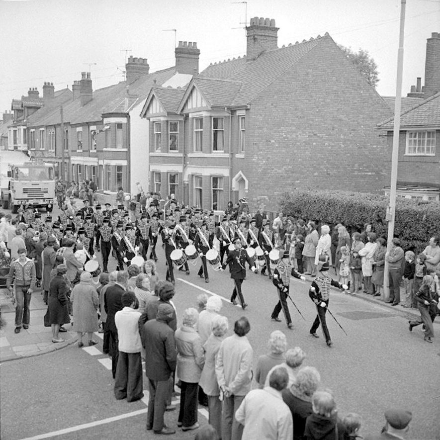 Edward Street, Nuneaton, silver jubilee carnival procession led by Band of the Junior Leaders' Reg.  18 June 1977 |  IMAGE LOCATION: (Warwickshire County Record Office)
