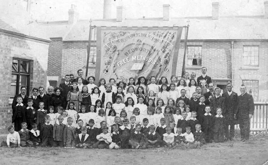 Bedworth, Free Methodist Sunday School, large group of children standing in front of a banner.  1900s |  IMAGE LOCATION: (Warwickshire County Record Office)