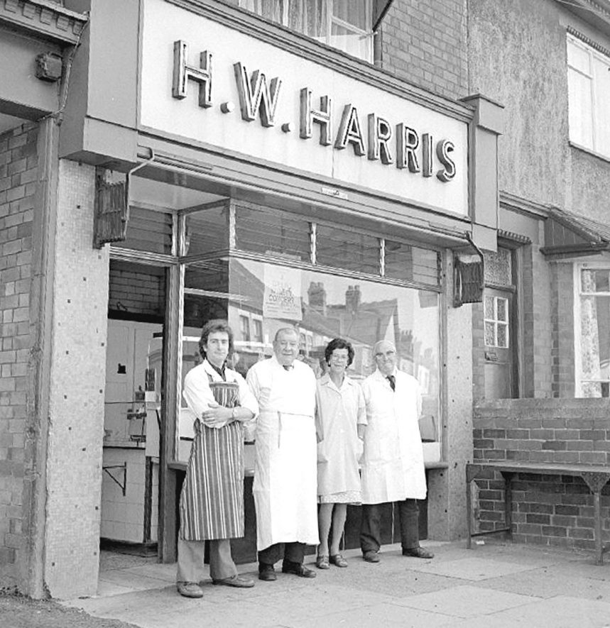 108, Croft Road, Stockingford.  H.W. Harris's butchers shop, with left to right: William Henry (Bill) Harris, (son of Harry),  Hilda Harris, (sister of Harry and William),  Harry Harris and William Harris.  1979 |  IMAGE LOCATION: (Warwickshire County Record Office) PEOPLE IN PHOTO: Harris, William Henry (Bill), Harris, William, Harris, Hilda, Harris, Harry