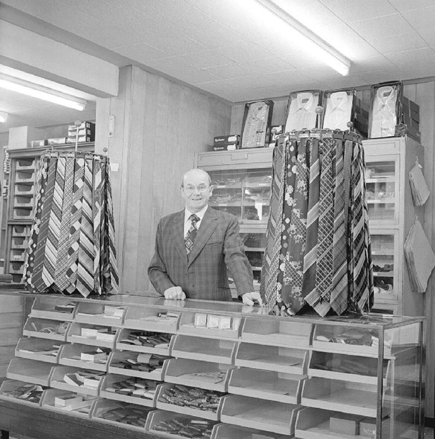 Mr Eric Richards, pictured in Fennells shop, prior to the business being sold to Riley's.  Mr Richards worked for Fennells for 54 years.  1980 |  IMAGE LOCATION: (Warwickshire County Record Office) PEOPLE IN PHOTO: Richards, Eric Stanley