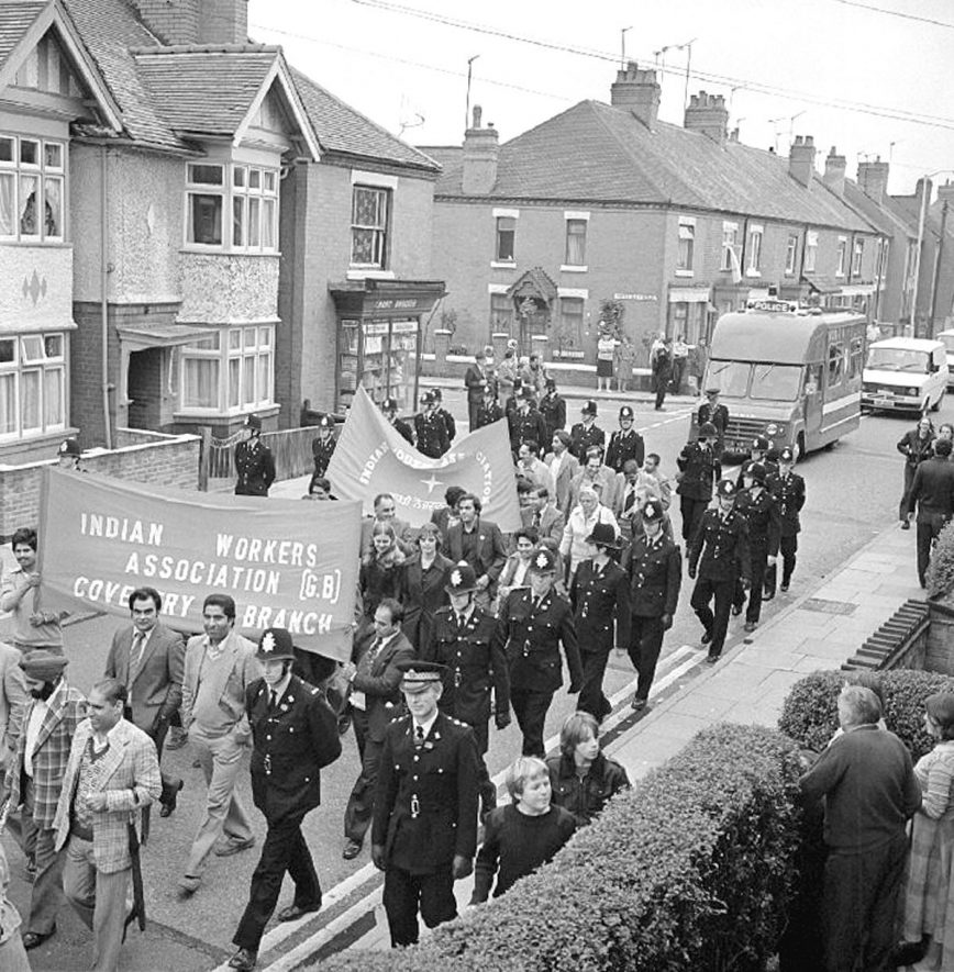 Anti-National Front March, seen here in Edward Street.  It started in the Pingles and 400 people took part, escorted by about 100 police officers, with a further 50 along the route, on the 28th September 1980. |  IMAGE LOCATION: (Warwickshire County Record Office)