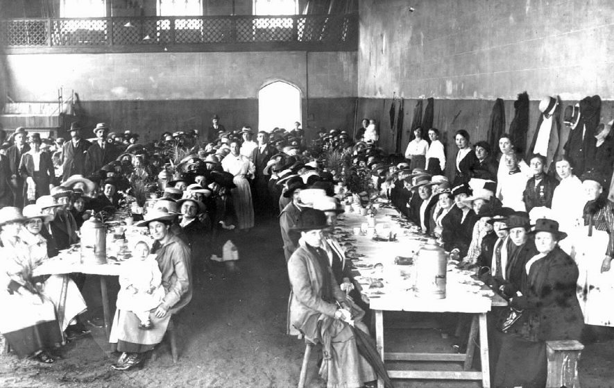 Primrose League Newdegate Habitation outing from Bedworth having tea at long trestle tables at Stoneleigh Abbey.  1920 |  IMAGE LOCATION: (Warwickshire County Record Office)