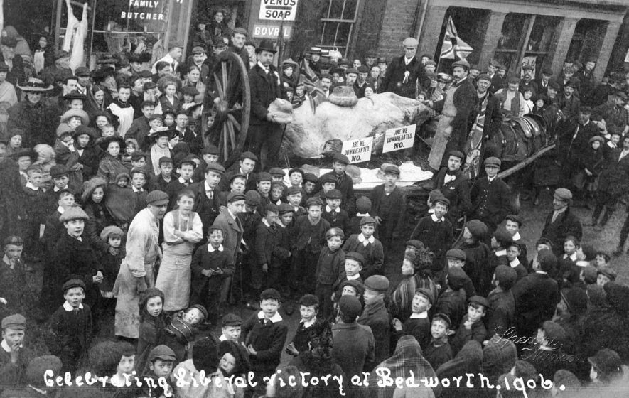 Group of people in street celebrating Liberal victory, Bedworth.  1906 |  IMAGE LOCATION: (Warwickshire County Record Office)
