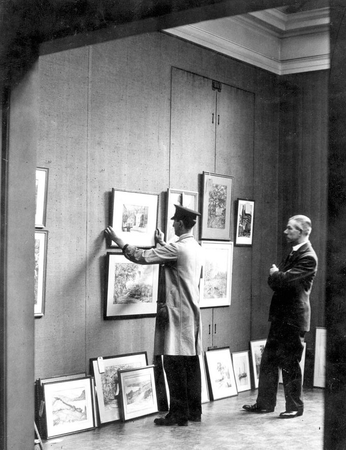 Hanging an exhibition of local artists in January 1937. |  IMAGE LOCATION: (Leamington Library)