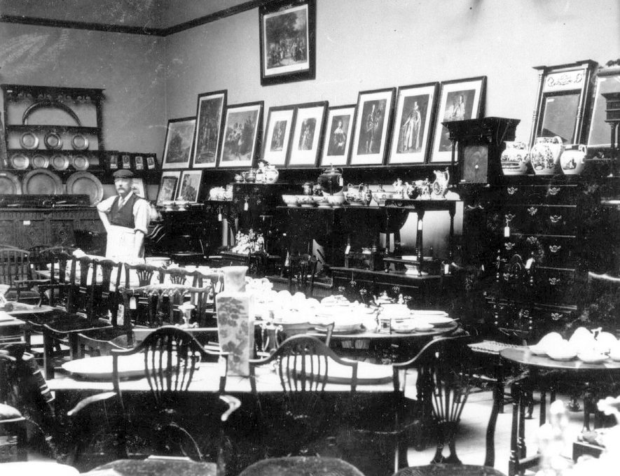 Collection of antiques and household furniture from Dr. E.W. Orton displayed for sale at Lovetts sale rooms, Bedworth.  May 1905 |  IMAGE LOCATION: (Warwickshire County Record Office)