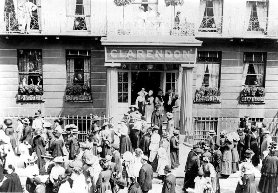A crowd of people outside the Clarendon Hotel, Leamington Spa.  1900s |  IMAGE LOCATION: (Leamington Library)