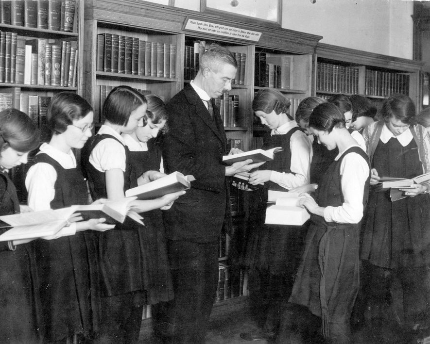 The Librarian gives a demonstration on how  to use the reference department, Leamington Spa public library.  1933 |  IMAGE LOCATION: (Leamington Library)