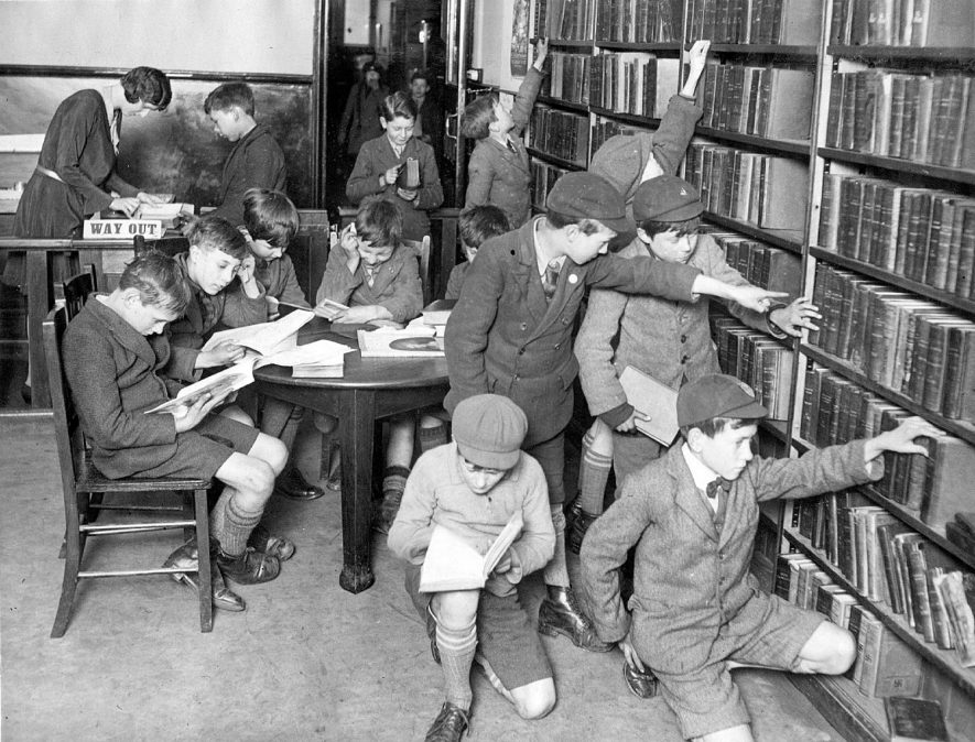 Children looking at books in the children's department of  the public library, Leamington Spa.  1930 |  IMAGE LOCATION: (Leamington Library)