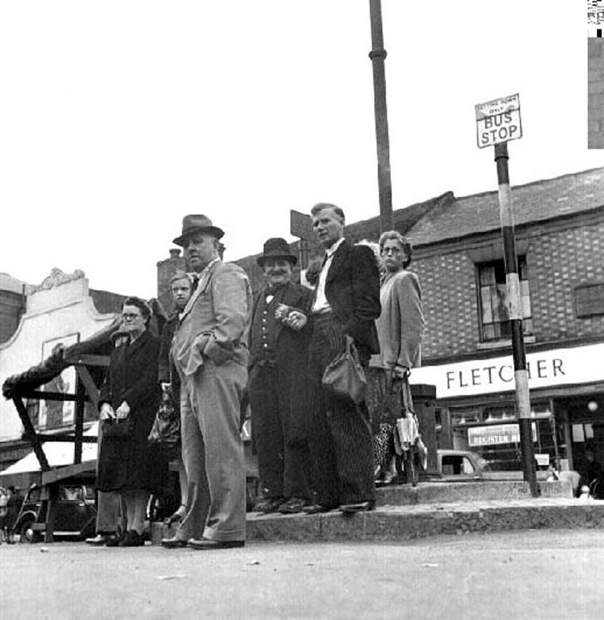 Bedworth, Market Square with bus queue.  1946