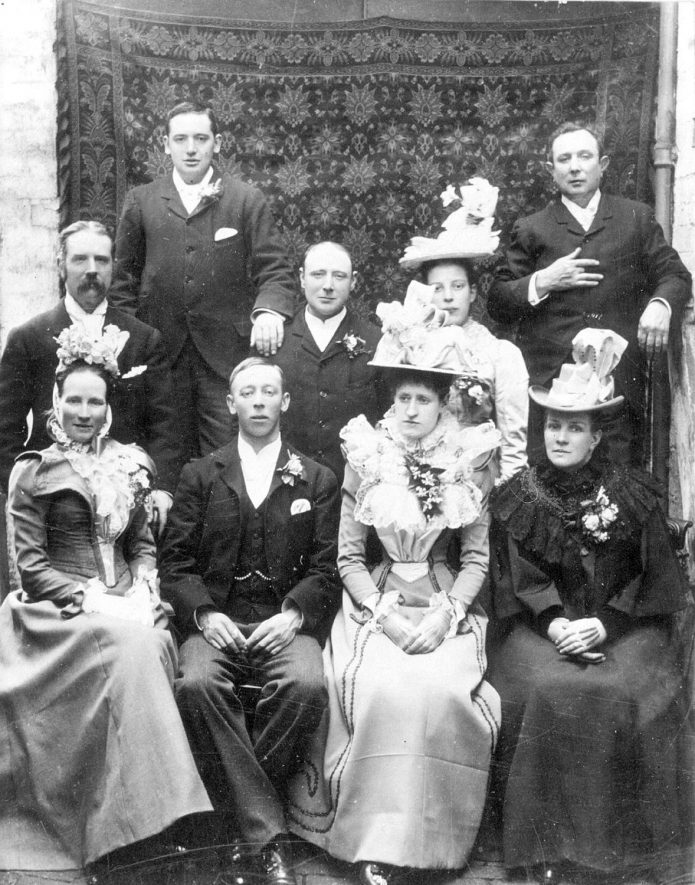 Photograph taken at The Newbold Inn following the wedding at All Saints Church, Leamington Spa on 30th March 1899 of Leonard Grimwood and Harriet Sophia Coughlan. The bridegroom was a butcher living at 122 Regent Street and the bride lived and worked at the Newbold Inn which was kept by her aunt and uncle. |  IMAGE LOCATION: (Leamington Library) PEOPLE IN PHOTO: Grimwood, Leonard, Coughlan, Harriet Sophia