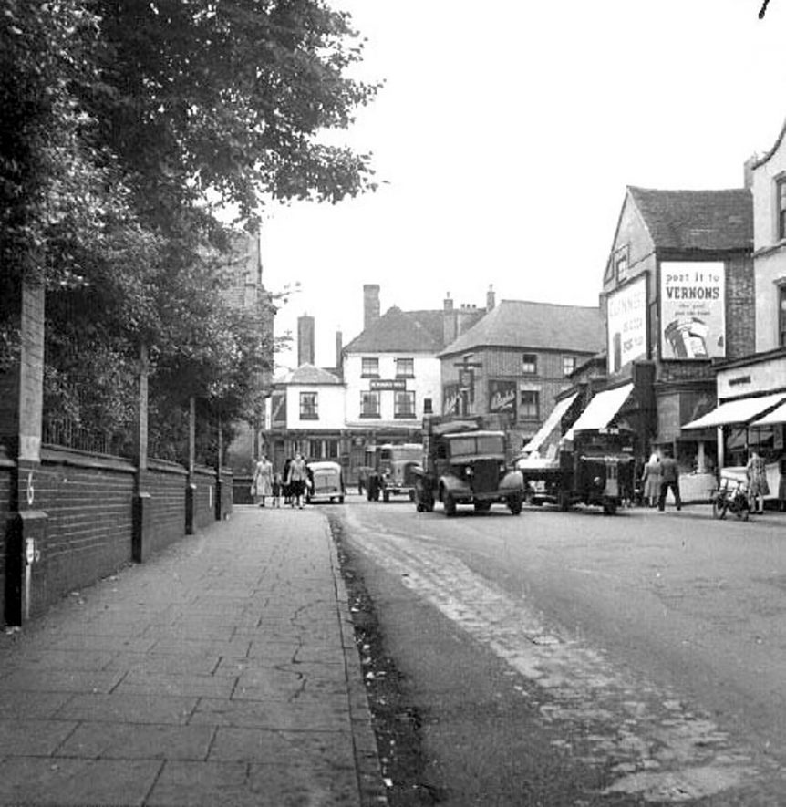 Bedworth, Market Place with pedestrians and motor vehicles.  1946 |  IMAGE LOCATION: (Warwickshire County Record Office)