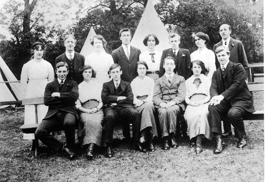 All Saints summer camp on church lands.  Back Row: L to R: Hilda Olorenshaw, Jack Blythe, Mrs Olorenshaw, Arthur Olorenshaw, Ms Robotham, William Ward, Agnes Robotham, Arthur Allen. Front Row left to right: Ted Rowlatt, Olive Robotham, Frank 'Bon' Atkins, Elsie Jeffery, Bernard Harrison, Mabel Amy Atkins, Arthur Robinson. [Olive Robotham later married Ted Rowlatt] c.1913 |  IMAGE LOCATION: (Leamington Library) IMAGE DATE: (c.1913) PEOPLE IN PHOTO: Ward, William, Rowlatt, Ted, Robotham, Olive, Robotham as a surname, Robinson, Arthur, Olorenshaw, Hilda, Olorenshaw, Arthur, Olorenshaw as a surname, Jeffrey, Elsie, Harrison, Bernard, Blythe, Jack, Atkins, Mabel Amy, Atkins, Frank, Allen, Arthur