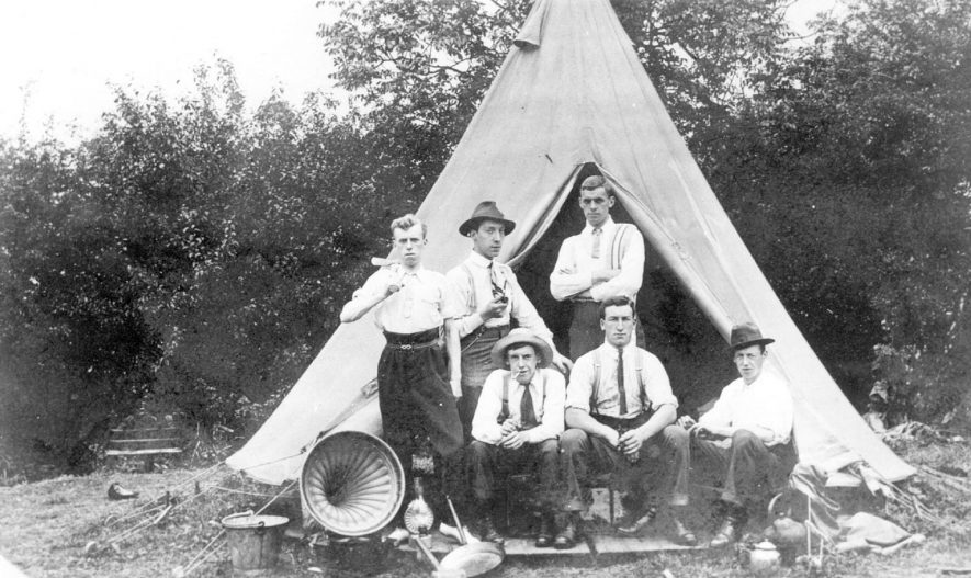 Church camp on church lands. William 'Bill' Ward is standing on the extreme left with Bernard Harrison next to him.  Frank 'Bon' Atkins is sitting on the extreme left.  c.1910 |  IMAGE LOCATION: (Leamington Library) IMAGE DATE: (c.1910) PEOPLE IN PHOTO: Ward, William, Harrison, Bernard, Atkins, Frank