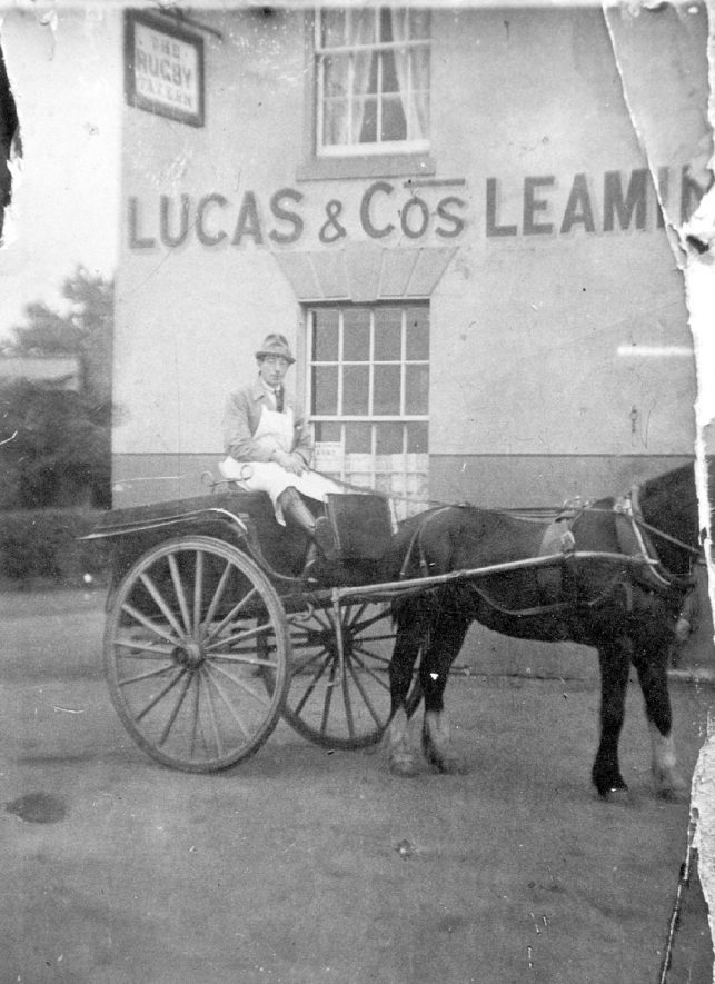 Mr E. Frank Russell, in his butchers wagon, outside the Rugby Tavern at New Cubbington.  1900s |  IMAGE LOCATION: (Leamington Library) PEOPLE IN PHOTO: Russell, E Frank