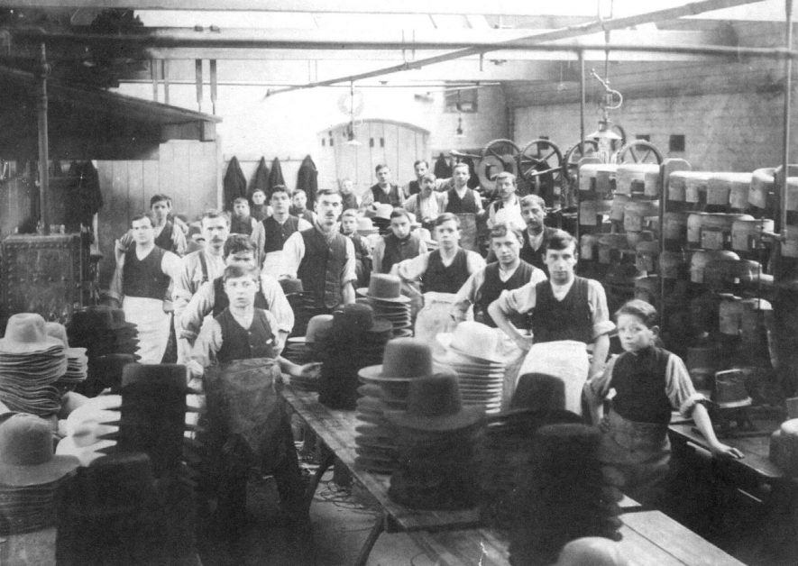 Interior of Luckham & Pickering's hat factory showing workforce and unfinished hats, Bedworth.  1900s |  IMAGE LOCATION: (Warwickshire County Record Office)